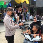 Polres Natuna Himbau Protokol Kesehatan dan Bagikan Masker Gratis Kepada Warga